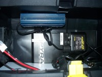 AC converter is mounted inside the bottom compartment, screwed to the bottom of the upper compartment
